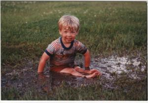 My 2-yr old son Matthew finding joy in a mud puddle